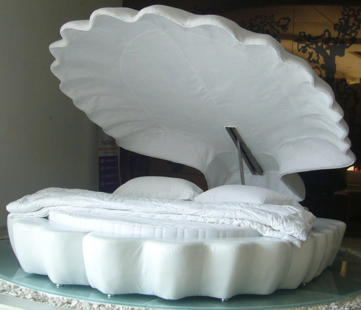Легло с формата на мидена черупка