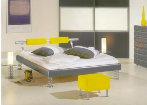 Contemporary-bedroom-with-light-colors-yellow-stools-with-white-mattress-drawers-and-cabinet